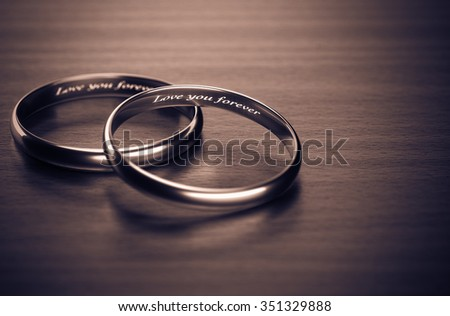 Love you forever ring in the background classic 3d rendering. - stock photo