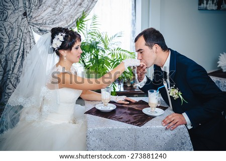 Love you honey.  Newly wed couple drinking cappuccino in cafe
