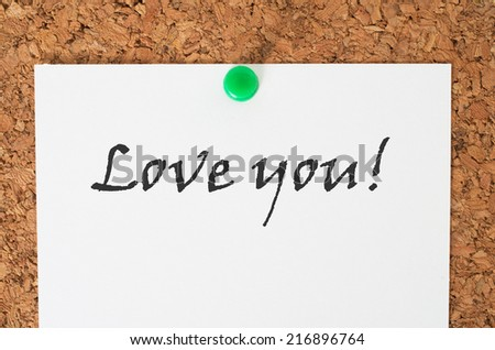 Love you note on a cork board - stock photo