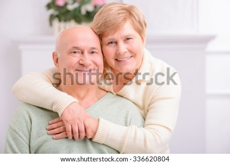 Love you so much. Pleasant loving content couple expressing positivity and embracing while resting at home - stock photo