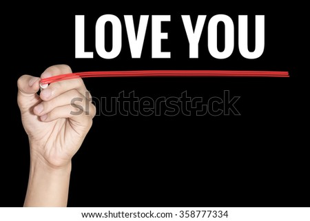 Love You word writing by men hand holding red highlighter pen on dark background - stock photo