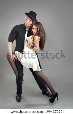 love young couple in hats - stock photo