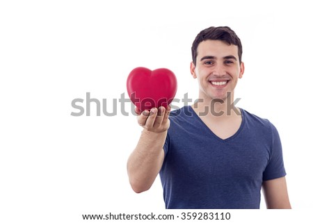Love.Young man smiling and holding red heart in his hand.Valentine's Day - stock photo