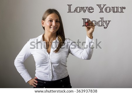 Love Your Body - Beautiful girl writing on transparent surface - horizontal image
