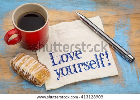 Love yourself advice - handwriting on a napkin with a cup of espresso coffee and cookie against grunge painted wood