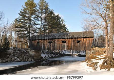 Lovejoy Bridge, a historic covered bridge in Andover, Maine - stock photo