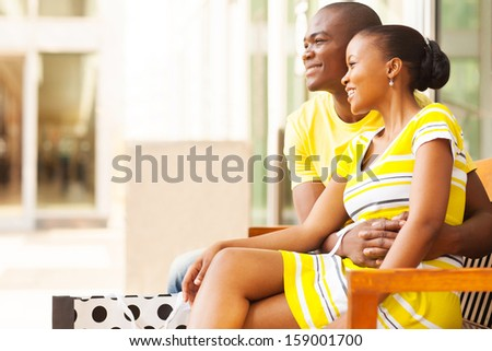 lovely african american couple resting after shopping - stock photo