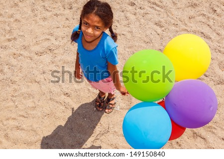 Lovely african american girl with balloons