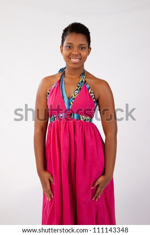 Lovely African American woman  with red dress, with eye contact and a friendly, happy, smile