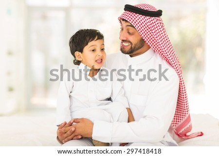 lovely Arabic man talking to his son - stock photo