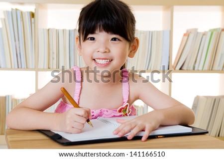 lovely asian girl writing - stock photo