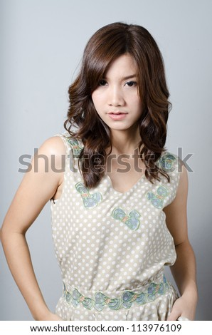 Lovely Asian model girl posing on gray background