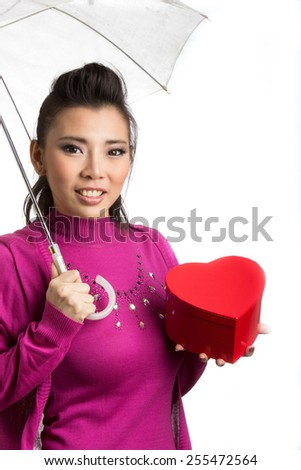 Lovely Asian santa girl hold gift on chirstmas day - stock photo