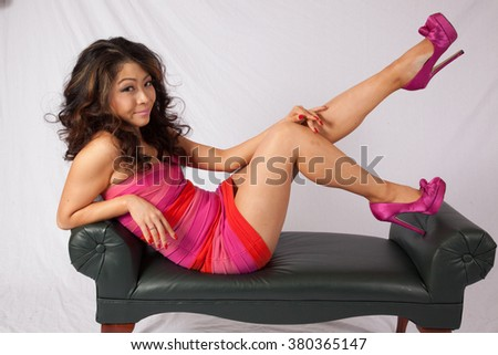 Lovely Asian woman sitting with a serious expression and looking at the camera
