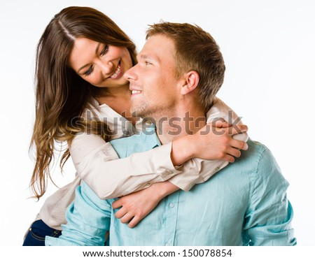 Lovely attractive couple hugs together, studio shot, white background