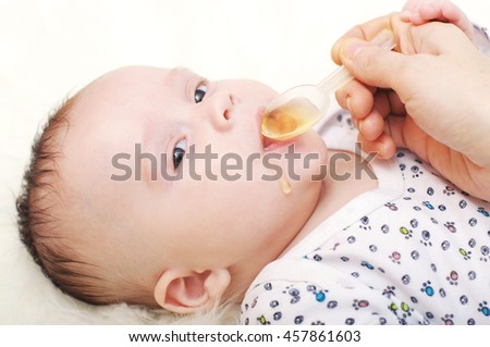 lovely baby age of 3,5 months drinking  juice