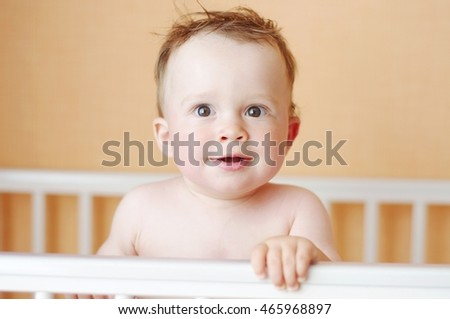 lovely baby age of 10 months in white bed