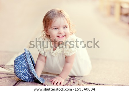Lovely baby girl happy smiling in fashion dress outdoor - stock photo