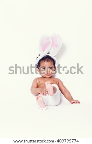 Lovely baby girl portrait sitting and wearing bunny ears