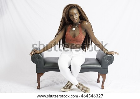 Lovely black woman sitting and  looking  thoughtful