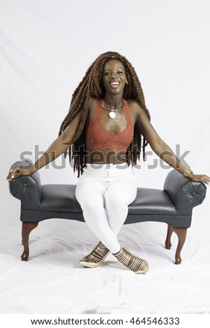 Lovely black woman sitting and smiling