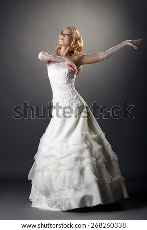 Lovely blonde bride dressed in elegant attire - stock photo