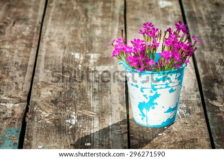 lovely bouquet of wild flowers in a jug handmade. focus on the petals of a flower. there is room for designer labels . Picture perfect for greetings and announcements - stock photo