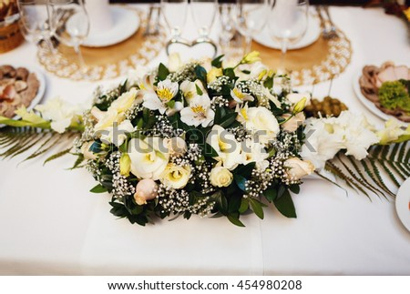Lovely bouquet on the wedding table for the newlyweds - stock photo