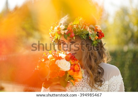Lovely bride with her flowers bouquet