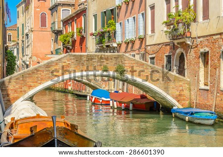 Lovely bridge on the canal of Venice, Burano. - stock photo