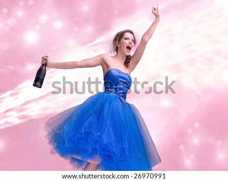 Lovely brunette in blue dress holding bottle of wine - stock photo