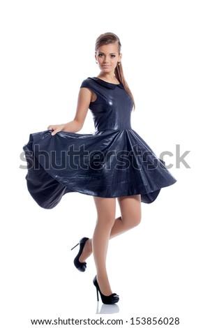 Lovely brunette posing in trendy dark blue dress - stock photo