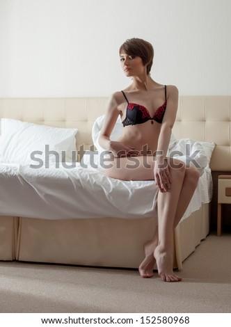 Lovely brunette with short hair posing in lingerie - stock photo