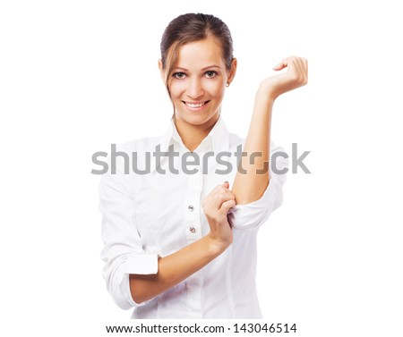 Lovely businesswoman in white shirt turning up sleeves - stock photo
