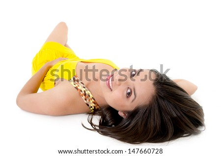 Lovely caucasian woman in yellow dress laying down on white - stock photo