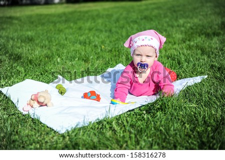 Lovely child playing on grass