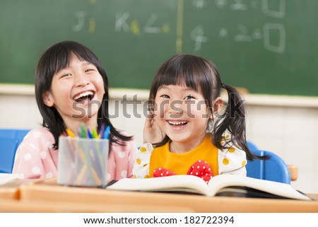 lovely children in the classroom - stock photo
