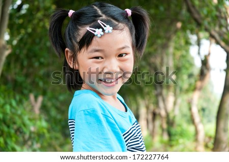 Lovely Chinese little girl in the park