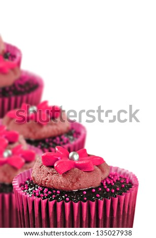 Lovely chocolate cupcakes decorated in pink - stock photo