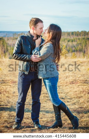 lovely couple boy and girl enjoying each other in nature