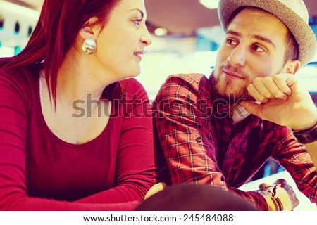 Lovely couple enjoying and having fun (image taken mostly behind glass reflection for desired look) - stock photo
