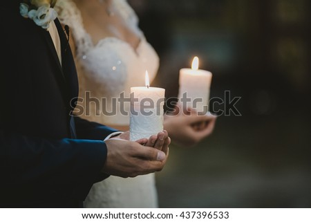 lovely couple holding big candles