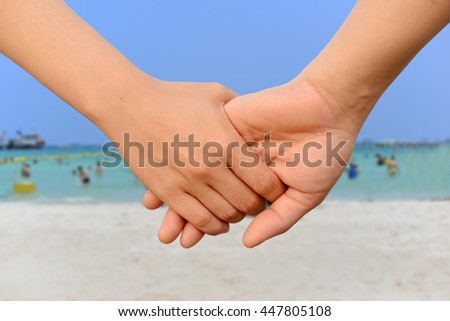 Lovely couple holding hands with beach background. Concept about love and relationship.