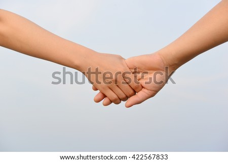 Lovely couple holding hands with nature background. Concept about love and relationship.