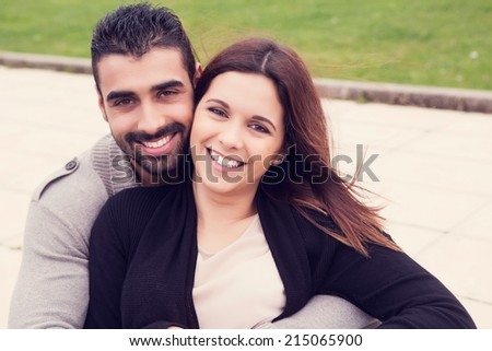 Lovely couple hugging each other in the city