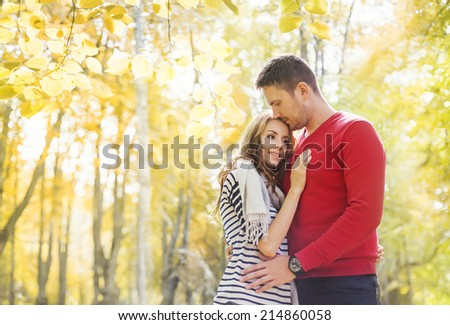 lovely couple in autumn park - stock photo