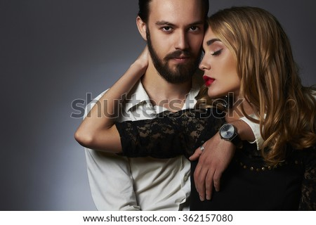 lovely couple in tender passion. Beautiful woman touching the man.beauty girl and boy together - stock photo