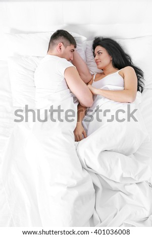 Lovely couple in white bed