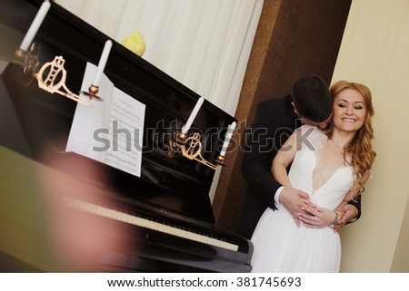 Lovely couple near a piano
