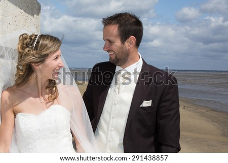 Lovely couple on the beach in wedding dress